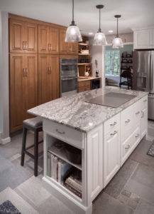 Burlington kitchen remodel island with end cap and flush stove top, full height cabinets with rollouts, and beverage nook.