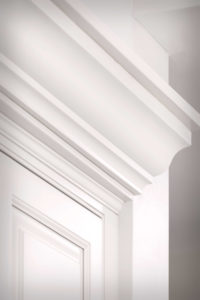 Crown moulding detail. To match cabinet heights from work area and range, we created extra height with custom crown moulding.