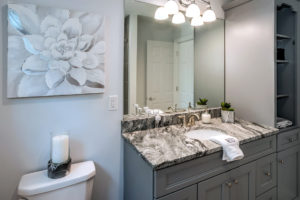 Detail view of bathroom vanity and linen closet in optional grey installed by Viking Kitchens at Gledhill Estates.