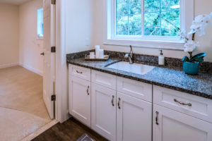 Detail view of basement sink cabinets installed by Viking Kitchens at Gledhill Estates.