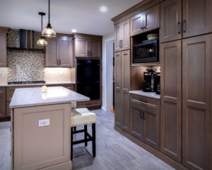 Full height cabinets flank a surpisingly useful coffee nook with his and hers coffee machines.