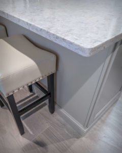 Detail of Rolling Fog Quartz on the island over Diamond Cabinetry in Maple Lambswool.