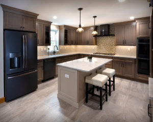 Rolling Fog Quartz counters, Diamond cabinetry and glass tile backsplashes.