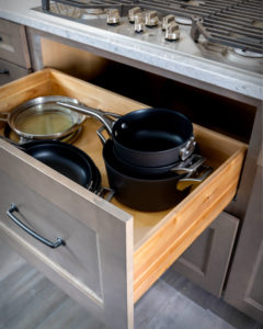 Diamond cabinets can provide extra storage is conveniently located under the stove top.