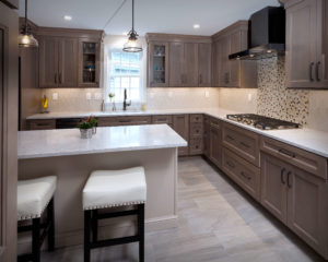 Diamond cabinets in Maple Seal complement the glass tile backsplash.