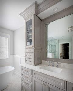 Higganum bathroom remodel showing custom cut mirrors and glass cabinets.