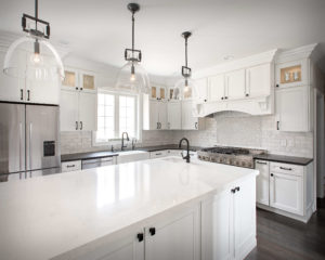 Farmhouse modern kitchen remodel with kitchen cabinets, countertops, and island installed by Viking Kitchens.