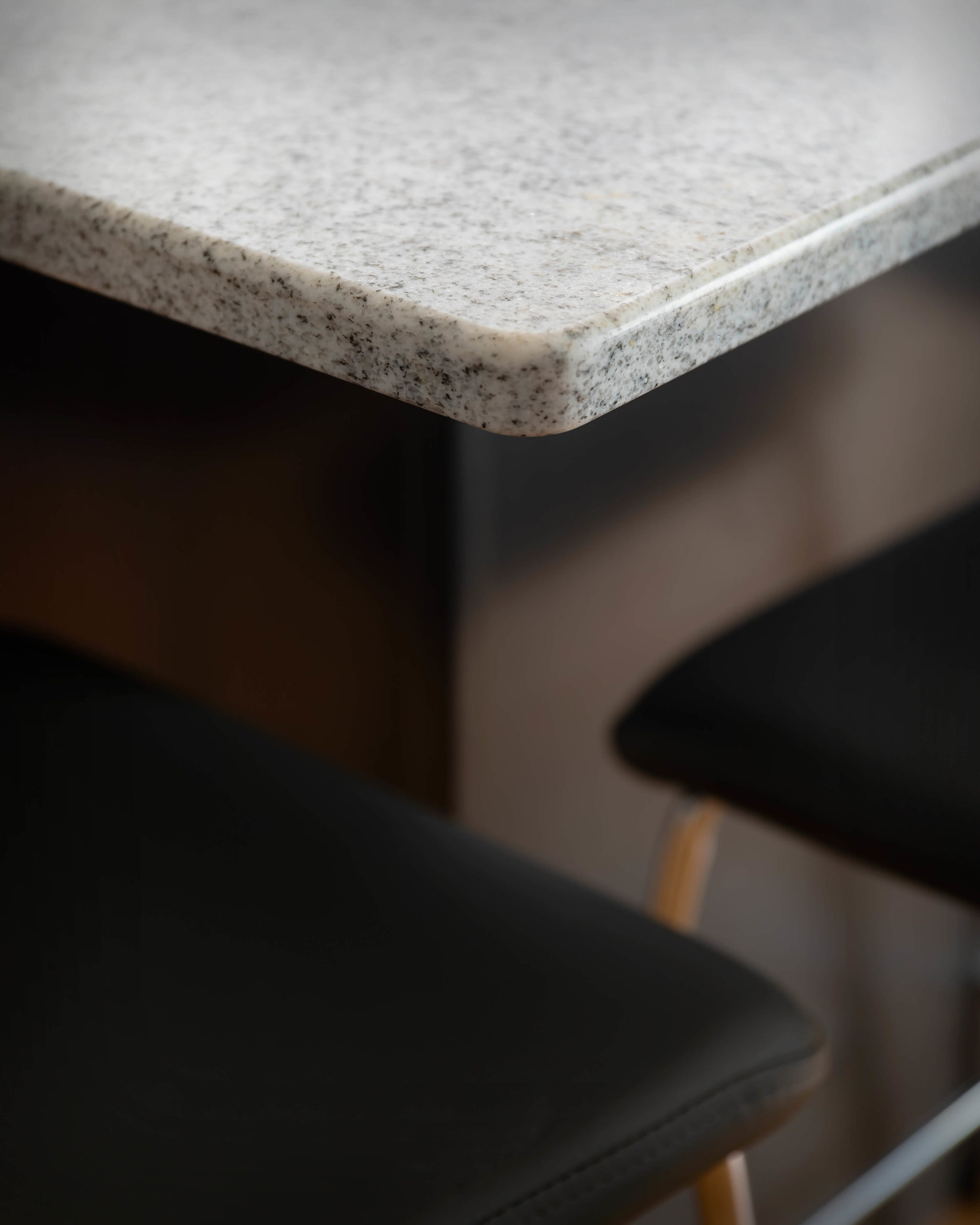 """Island counter edge detail view featuring 3/8"""" round edge in new kitchen and bathroom project in Middletown."""