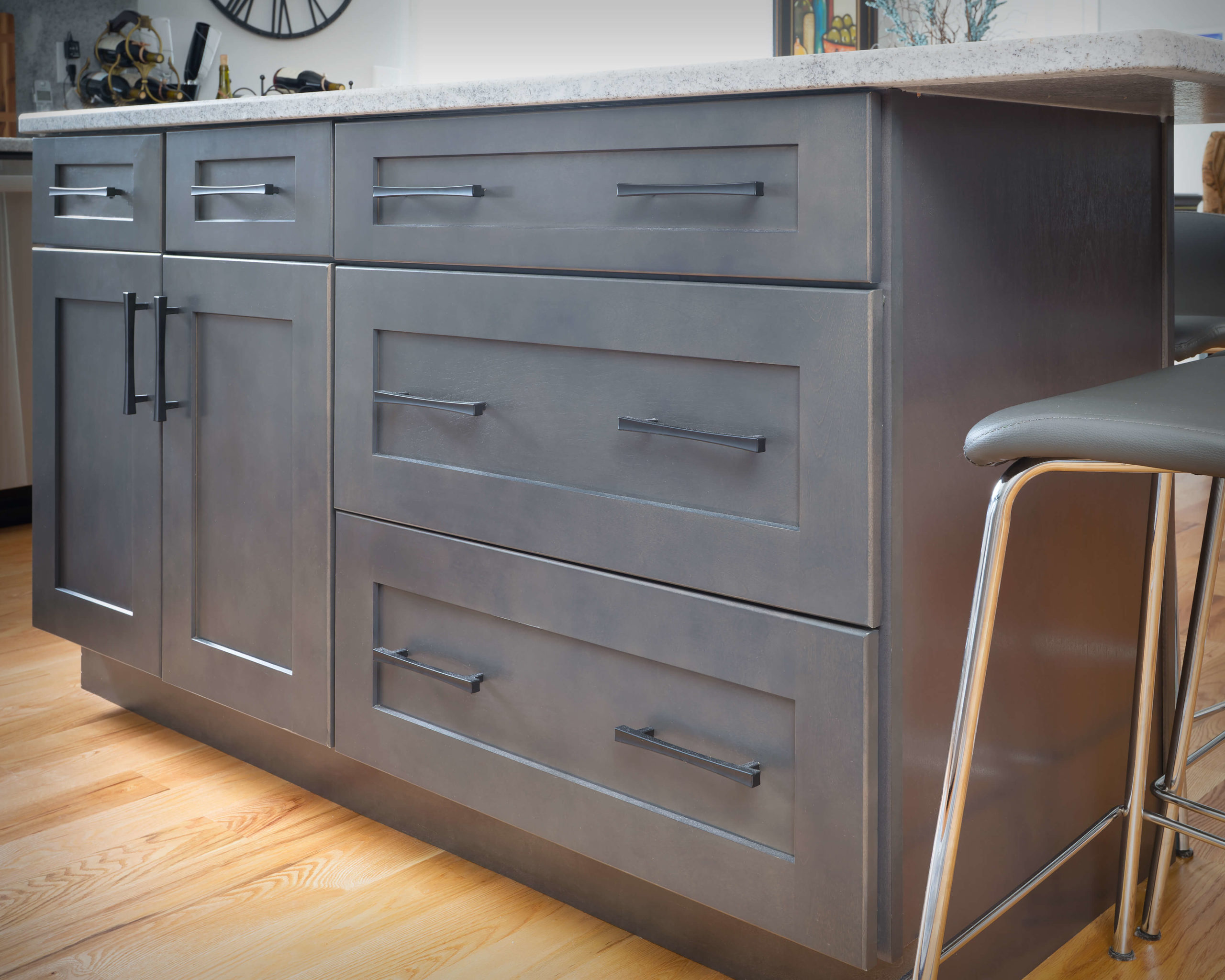 Island counter rear view featuring Matte Black bar pulls in new kitchen and bathroom project in Middletown.