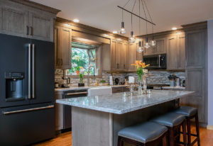 View of the island and perimeter cabinets AFTER work on this kitchen remodel in Wallingford, CT.