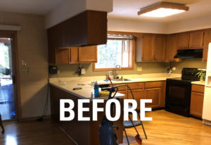 View of the island and perimeter cabinets BEFORE work on this kitchen remodel in Wallingford, CT.