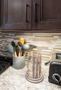 Cabinet, Backsplash and Counter Details: The backsplash is MSI Arctic Storm with Pewter Permacolor grout. The hardware is Berenson Hardware bar pulls in Slate. The counter is Cambria New Quay quartz.