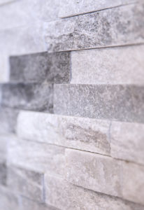 Detail of the fireplace tile AFTER work on this kitchen remodel in West Hartford.