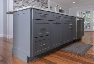 Detail of the Homecrest island cabinets in Sedona door style with matching drawer front in Galaxy Opaque.