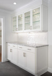 View of the cabinetry in the Butler's Pantry BEFORE work in the West Hartford kitchen remodel showing glass door fronts and interior lighting.