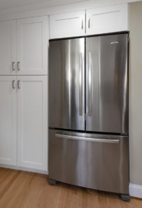 Custom full height cabinets extend to the garage for valuable added storage space.